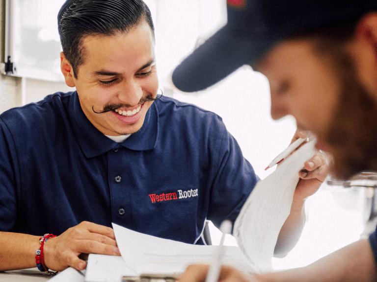 western rooter plumbers customer service smiling man