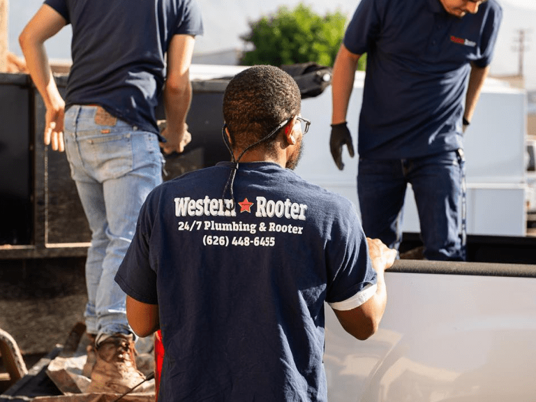 western rooter plumber with shirt with plumber logo